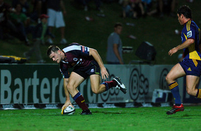 12 MAY 2006 TOWNSVILLE, QLD - Ben Tune scores during the first half of the Queensland Reds Super 14 match against the Highlanders at Dairy Farmers Stadium, Townsville - PHOTO: CAMERON LAIRD