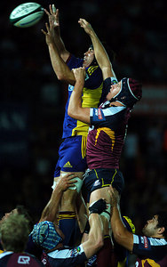 12 MAY 2006 TOWNSVILLE, QLD - Hoani MacDonald (left) and Mitchell Chapman (right) contest a lineout during the Queensland Reds Super 14 match against the Highlanders at Dairy Farmers Stadium, Townsville - PHOTO: CAMERON LAIRD