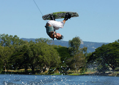 08 JUL 2006 TOWNSVILLE, QLD - Brisbane's Aaron Bullock performs at the Coca Cola Ross River Rampage national wakeboarding competition.  It is part of a nine day program celebrating the opening of the Thuringowa Riverway project - PHOTO: CAMERON LAIRD