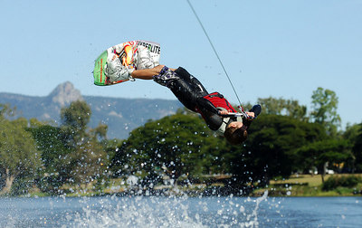 08 JUL 2006 TOWNSVILLE, QLD - Townsville's Joel Farmer performs at the Coca Cola Ross River Rampage national wakeboarding competition.  It is part of a nine day program celebrating the opening of the Thuringowa Riverway project - PHOTO: CAMERON LAIRD