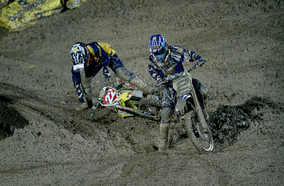22 November 2008 Townsville, Qld - Chad Reed falls in the semi-final to put eventual round winner Jay Marmont into the final.  Round 6 of Super X at Townsville's Dairy Farmers Stadium - Photo: Cameron Laird (Ph: 0418 238811)