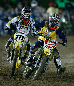 22 November 2008 Townsville, Qld - Chad Reed (22) leads Cameron Taylor (111) into the first corner during Round 6 of Super X at Townsville's Dairy Farmers Stadium - Photo: Cameron Laird (Ph: 0418 238811)