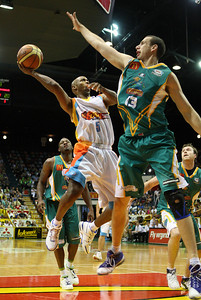 20 Feb 2008 Townsville, Qld, Australia - Gold Coast's Jason Crowe shoots over an outstretched Greg Vanderjagt - Townsville Crocodiles v Gold Coast Blaze (Townsville Entertainment & Convention Centre) - PHOTO: CAMERON LAIRD (Ph: 0418238811)