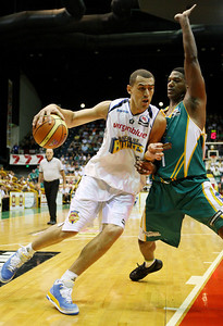 09 Feb 2008 Townsville, Qld, Australia - Dusty Rychart drives around Townsville's Galen Young - Townsville Crocodiles v Brisbane Bullets (Townsville Entertainment & Convention Centre) - PHOTO: CAMERON LAIRD (Ph: 0418238811)