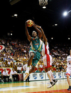01 Dec 2007 Townsville, Qld - Crocodiles import Galen Young flies to the basket past Perth's Gerald Brown - Townsville Crocodiles v Perth Wildcats (Townsville Entertainment & Convention Centre) - PHOTO: CAMERON LAIRD (Ph: 0418 238811)