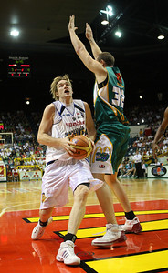 09 Feb 2008 Townsville, Qld, Australia - Dillon Boucher drives around Townsville's Ben Pepper - Townsville Crocodiles v Brisbane Bullets (Townsville Entertainment & Convention Centre) - PHOTO: CAMERON LAIRD (Ph: 0418238811)