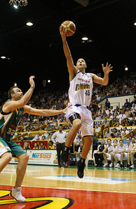 09 Feb 2008 Townsville, Qld, Australia - Dusty Rychart flies to the basket - Townsville Crocodiles v Brisbane Bullets (Townsville Entertainment & Convention Centre) - PHOTO: CAMERON LAIRD (Ph: 0418238811)