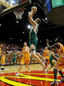 08 Dec 2007 Townsville, Qld - Ben Pepper flies to the basket to score for the Crocodiles - Townsville Crocodiles v Singapore Slingers (Townsville Entertainment & Convention Centre) - PHOTO: CAMERON LAIRD (Ph: 0418 238811)