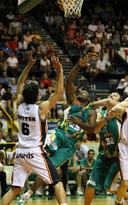 20 Oct 2007 Townsville, Qld, Australia - New Crocodiles import Corey Williams lands an amazing fall-away shot in the opening stanza - Townsville Crocodiles v Adelaide 36'ers - PHOTO: CAMERON LAIRD (Ph: 0418 238811)