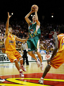 08 Dec 2007 Townsville, Qld - Crocodiles captain John Rillie looks for an outlet pass - Townsville Crocodiles v Singapore Slingers (Townsville Entertainment & Convention Centre) - PHOTO: CAMERON LAIRD (Ph: 0418 238811)