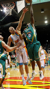 20 Feb 2008 Townsville, Qld, Australia - Corey Williams shoots over Gold Coast's Scott McGregor during the Crocodiles 97-89 win over the Blaze - Townsville Crocodiles v Gold Coast Blaze (Townsville Entertainment & Convention Centre) - PHOTO: CAMERON LAIRD (Ph: 0418238811)