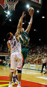 20 Feb 2008 Townsville, Qld, Australia - Greg Vanderjagt shoots over Gold Coast's Luke Whitehead - Townsville Crocodiles v Gold Coast Blaze (Townsville Entertainment & Convention Centre) - PHOTO: CAMERON LAIRD (Ph: 0418238811)