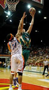 20 Feb 2008 Townsville, Qld, Australia - Greg Vanderjagt shoots over Gold Coast's Luke Whitehead - Townsville Crocodiles v Gold Coast Blaze (Townsville Entertainment & Convention Centre) - PHOTO: CAMERON LAIRD (Ph: 0418238811)