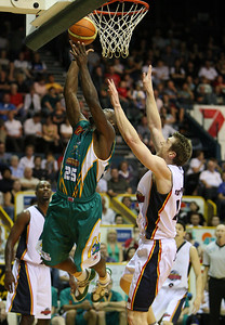 "20 Oct 2007 Townsville, Qld, Australia - Corey ""Homocide"" Williams flies to the basket to score for the Crocodiles - Townsville Crocodiles v Adelaide 36'ers - PHOTO: CAMERON LAIRD (Ph: 0418 238811)"