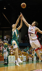 01 Dec 2007 Townsville, Qld - Crocodiles skipper John Rillie shoots three over Perth's Peter Crawford - Townsville Crocodiles v Perth Wildcats (Townsville Entertainment & Convention Centre) - PHOTO: CAMERON LAIRD (Ph: 0418 238811)