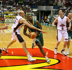 20 Oct 2007 Townsville, Qld, Australia - Crocodiles import Corey Williams is fouled by Adelaide's David Cooper - Townsville Crocodiles v Adelaide 36'ers - PHOTO: CAMERON LAIRD (Ph: 0418 238811)