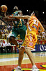 "08 Dec 2007 Townsville, Qld - Corey ""Homocide"" Williams is fouled hard by Singapore's Blagoj Janev - Townsville Crocodiles v Singapore Slingers (Townsville Entertainment & Convention Centre) - PHOTO: CAMERON LAIRD (Ph: 0418 238811)"