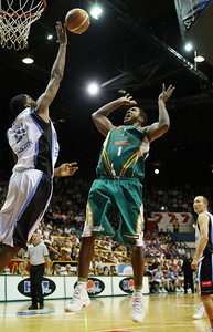 12 Jan 2008 Townsville, Qld, Australia - Despite NZ import Derrick Alston's best efforts Townsville's Galen Young scores in the second quarter - Townsville Crocodiles v New Zealand Breakers (Townsville Entertainment & Convention Centre) - PHOTO: CAMERON LAIRD (Ph: 0418238811)