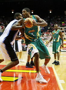 12 Jan 2008 Townsville, Qld, Australia - Townsville's Galen Young spins around NZ import Derrick Alston - Townsville Crocodiles v New Zealand Breakers (Townsville Entertainment & Convention Centre) - PHOTO: CAMERON LAIRD (Ph: 0418238811)
