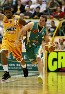 08 Dec 2007 Townsville, Qld - Kelvin Robertson brings the ball up court part Singapore's Mike Helms - Townsville Crocodiles v Singapore Slingers (Townsville Entertainment & Convention Centre) - PHOTO: CAMERON LAIRD (Ph: 0418 238811)
