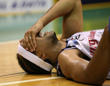09 Feb 2008 Townsville, Qld, Australia - C.J Bruton in agony after an eye injury - Townsville Crocodiles v Brisbane Bullets (Townsville Entertainment & Convention Centre) - PHOTO: CAMERON LAIRD (Ph: 0418238811)