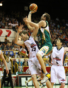 20 Oct 2007 Townsville, Qld, Australia - Ben Pepper flies over Neil Mottram in the opening period - Townsville Crocodiles v Adelaide 36'ers - PHOTO: CAMERON LAIRD (Ph: 0418 238811)