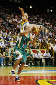 20 Feb 2008 Townsville, Qld, Australia - Townsville's Drew Williamson powers past James Harvey - Townsville Crocodiles v Gold Coast Blaze (Townsville Entertainment & Convention Centre) - PHOTO: CAMERON LAIRD (Ph: 0418238811)
