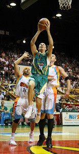 20 Feb 2008 Townsville, Qld, Australia - Townsville's John Rillie flies past Luke Whitehead (left) and Ben Melmeth (right) - Townsville Crocodiles v Gold Coast Blaze (Townsville Entertainment & Convention Centre) - PHOTO: CAMERON LAIRD (Ph: 0418238811)