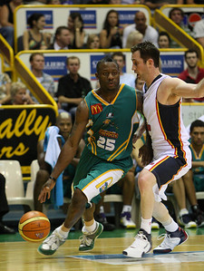 20 Oct 2007 Townsville, Qld, Australia - Corey Williams drives around Adelaide's Brett Maher - Townsville Crocodiles v Adelaide 36'ers - PHOTO: CAMERON LAIRD (Ph: 0418 238811)