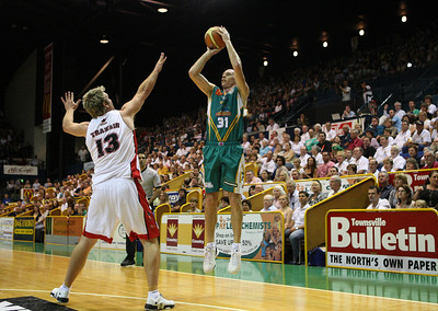 01 Dec 2007 Townsville, Qld - John Rillie shoots a three to close out the opening half - Townsville Crocodiles v Perth Wildcats (Townsville Entertainment & Convention Centre) - PHOTO: CAMERON LAIRD (Ph: 0418 238811)