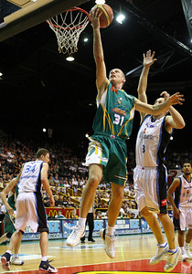 12 Jan 2008 Townsville, Qld, Australia - Crocodiles captain John Rillie flies to the basket beating NZ's Phill (CORRECT SPELLING) Jones - Townsville Crocodiles v New Zealand Breakers (Townsville Entertainment & Convention Centre) - PHOTO: CAMERON LAIRD (Ph: 0418238811)