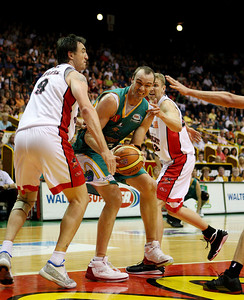 01 Dec 2007 Townsville, Qld - Ben Pepper tries to power past Wildcat's centre Paul Rogers - Townsville Crocodiles v Perth Wildcats (Townsville Entertainment & Convention Centre) - PHOTO: CAMERON LAIRD (Ph: 0418 238811)