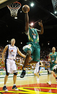 12 Jan 2008 Townsville, Qld, Australia - Townsville superstar Corey Williams floats to the basket - Townsville Crocodiles v New Zealand Breakers (Townsville Entertainment & Convention Centre) - PHOTO: CAMERON LAIRD (Ph: 0418238811)