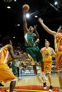 08 Dec 2007 Townsville, Qld - Crocodiles import Galen Young flies to the basket - Townsville Crocodiles v Singapore Slingers (Townsville Entertainment & Convention Centre) - PHOTO: CAMERON LAIRD (Ph: 0418 238811)