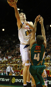 09 Feb 2008 Townsville, Qld, Australia - Mick Hill flies over Townsville's Kelvin Robertson - Townsville Crocodiles v Brisbane Bullets (Townsville Entertainment & Convention Centre) - PHOTO: CAMERON LAIRD (Ph: 0418238811)