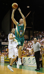 09 Feb 2008 Townsville, Qld, Australia - Crocs captain John Rillie gets a flying 3 pt attempt away - Townsville Crocodiles v Brisbane Bullets (Townsville Entertainment & Convention Centre) - PHOTO: CAMERON LAIRD (Ph: 0418238811)