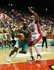 01 Dec 2007 Townsville, Qld - Townsville's Corey Williams drives around Perth's Gerald Brown - Townsville Crocodiles v Perth Wildcats (Townsville Entertainment & Convention Centre) - PHOTO: CAMERON LAIRD (Ph: 0418 238811)