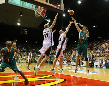 20 Oct 2007 Townsville, Qld, Australia - Greg Vandrejagt shoots over the Adelaide defence - Townsville Crocodiles v Adelaide 36'ers - PHOTO: CAMERON LAIRD (Ph: 0418 238811)