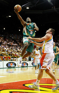 "20 Feb 2008 Townsville, Qld, Australia - Townsville's Corey ""Homicide"" Williams puts an amazing move on Gold Coast's Casey Frank - Townsville Crocodiles v Gold Coast Blaze (Townsville Entertainment & Convention Centre) - PHOTO: CAMERON LAIRD (Ph: 0418238811)"