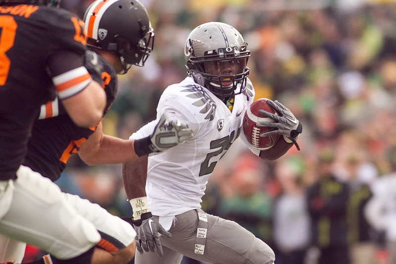 Oregon Ducks running back Kenjon Barner (24) runs the ball with a look on fear on his face at the 114th annual Civil War. UO Defeated OSU 37-20 in the game at Reser Stadium in Corvallis Oregon.