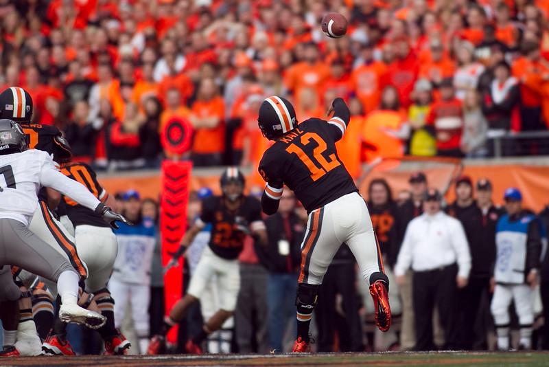 Oregon State Beavers quarterback Ryan Katz (12) passes the ball to Oregon State Beavers wide receiver Jordan Bishop (23) at the 114th annual Civil War. UO Defeated OSU 37-20 in the game at Reser Stadium in Corvallis Oregon.