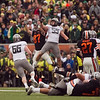 Oregon State Beavers tight end Joe Halahuni (87) and Oregon Ducks linebacker Casey Matthews (55) jump for a pass at the 114th annual Civil War. UO Defeated OSU 37-20 in the game at Reser Stadium in Corvallis Oregon.