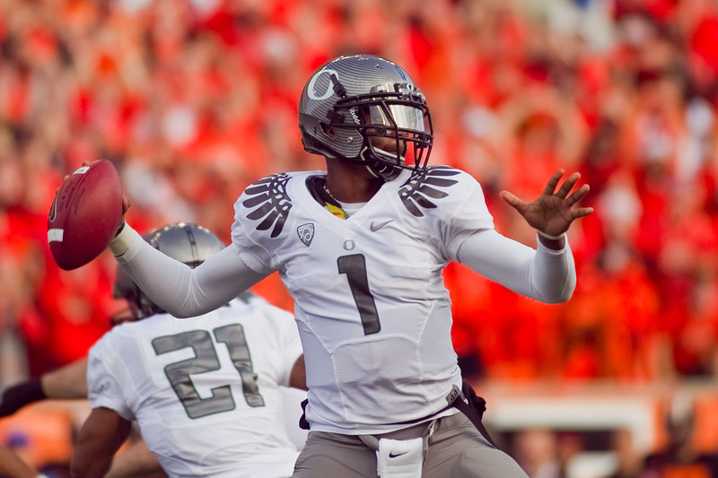Oregon Ducks quarterback Darron Thomas (1) looks to pass at the 114th annual Civil War. UO Defeated OSU 37-20 in the game at Reser Stadium in Corvallis Oregon.