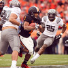 Oregon State Beavers running back Jacquizz Rodgers (1) runs the ball through the tough Oregon defense at the 114th annual Civil War. UO Defeated OSU 37-20 in the game at Reser Stadium in Corvallis Oregon.