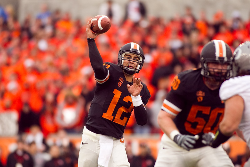 Oregon State Beavers quarterback Ryan Katz (12) throws the ballat the 114th annual Civil War. UO Defeated OSU 37-20 in the game at Reser Stadium in Corvallis Oregon.