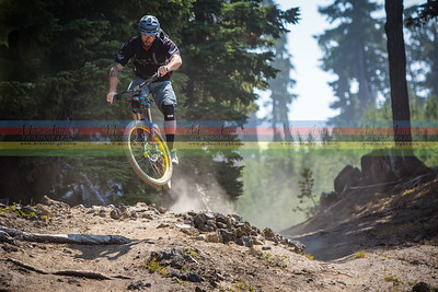 Vital MTB photographer Dennis Yuroshek isn't afraid to take the jump line with his pack loaded up with equipment on race day.
