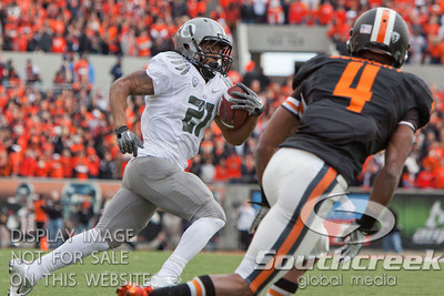 Oregon RB LaMichael James (21) makes a cut to the corner of the end zone but Oregon State Bb James Dockery (4) had other plans during the 2010 Civil War game at Reser Stadium, Corvallis, Oregon.  James was dropped for a 2 yard loss but the Oregon Ducks defeated the Oregon State Beavers 37-20 to advance to the BCS National Championship game in Glendale, Arizona.