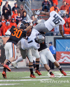 Oregon and Oregon State players scramble for a loose ball during the 2010 Civil War game at Reser Stadium, Corvallis, Oregon.  The Oregon Ducks defeated the Oregon State Beavers 37-20 to advance to the BCS National Championship game in Glendale, Arizona.