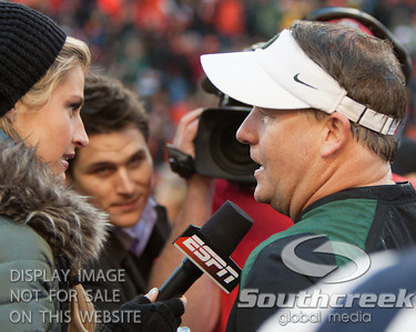 Oregon coach Chip Kelly (left) speaks with ESPN's sideline reporter Erin Andrews after the 2010 Civil War game at Reser Stadium, Corvallis, Oregon.  The Oregon Ducks defeated the Oregon State Beavers 37-20 to advance to the BCS National Championship game in Glendale, Arizona.