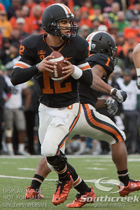 Oregon State QR Ryan Katz (12) looks to make a pass after a fake handoff to  RB Jacqizz Rodgers (1) during the 2010 Civil War game at Reser Stadium, Corvallis, Oregon.  The Oregon Ducks beat the Oregon State beavers 40-20.